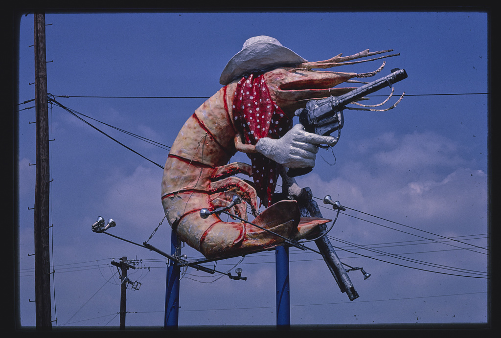 The most Texas image I could find was a shrimp in a cowboy hat holding two six shooters.